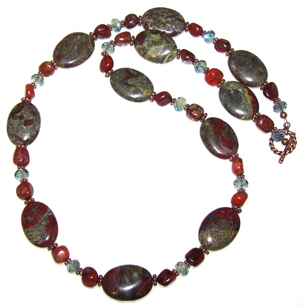 This beautiful necklace features Dragon Blood Jasper 18x25mm Semiprecious Puff Oval Beads and Brecciated Jasper 7x10mm Irregular Nugget Beads.  It uses Antique Copper Beads & Findings along with faceted crystal rondelles.