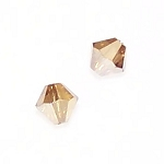 1 Dozen Preciosa 6mm Bicones - Crystal Golden Flare